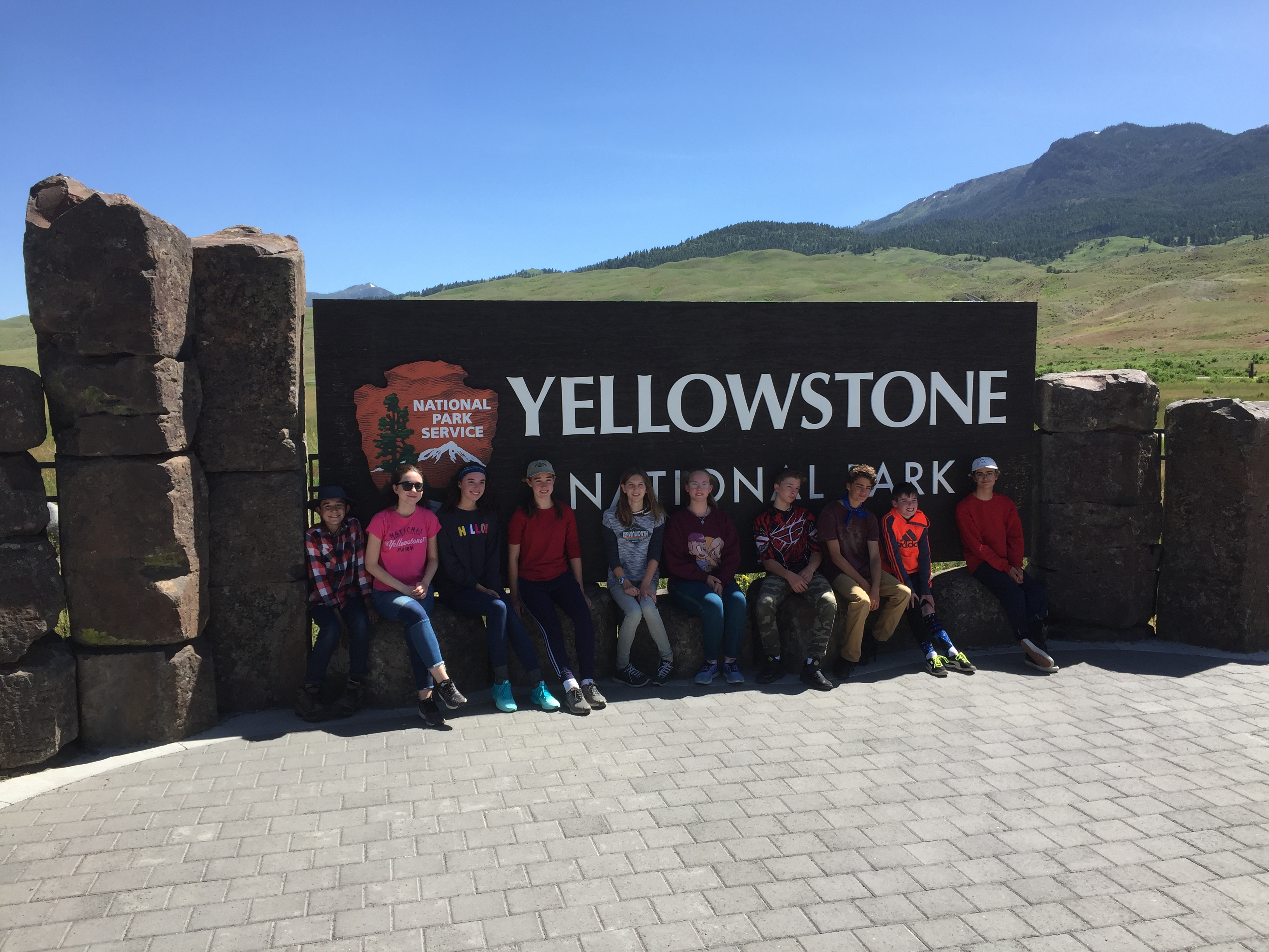 Students standing in front of Yellowstone sign