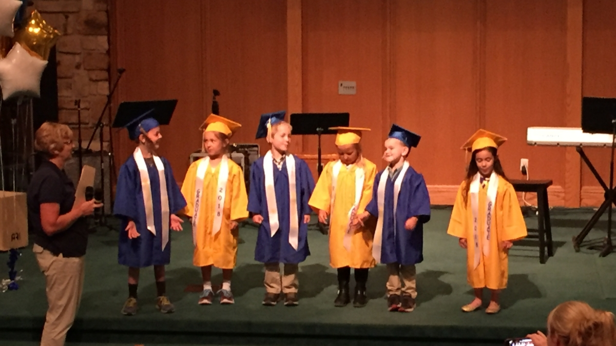 Upper Valley Christian School Kindergarten students in caps and gowns